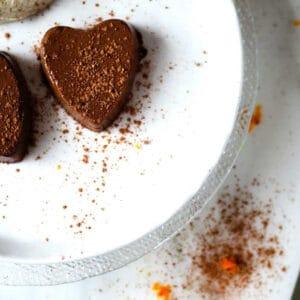 A chocolate orange semifreddo heart with cacao and orange zest sprinkles