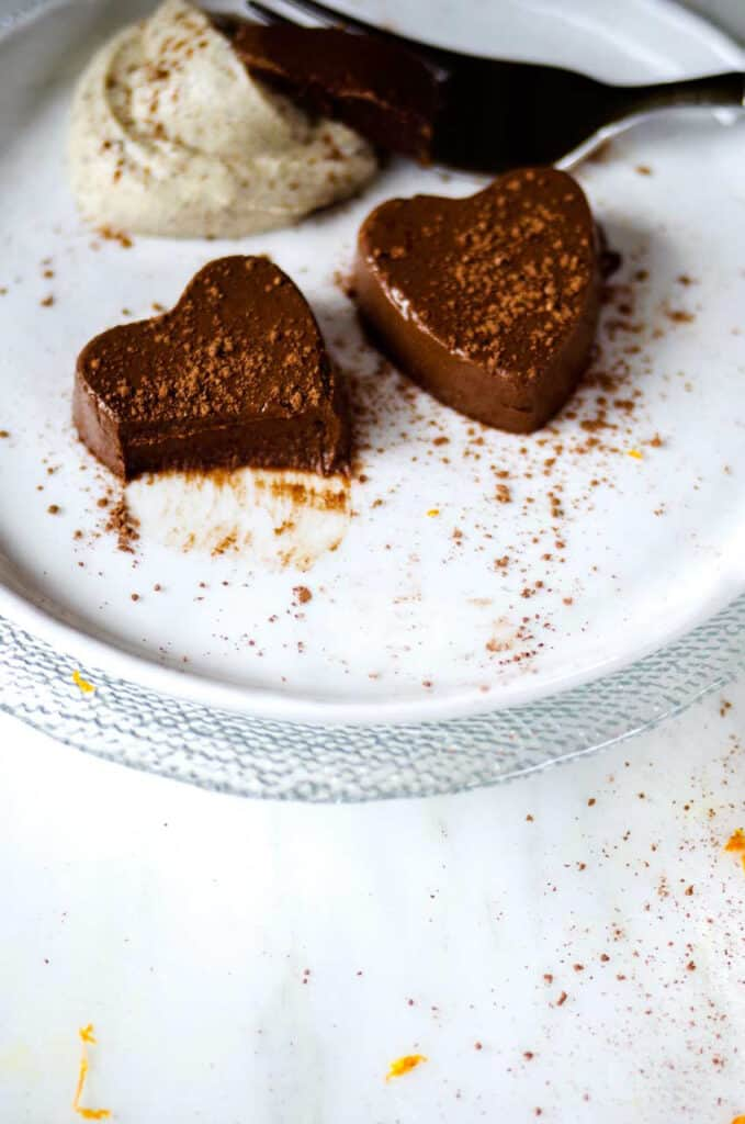 Two chocolate semifreddo hearts with a bite taken out of one