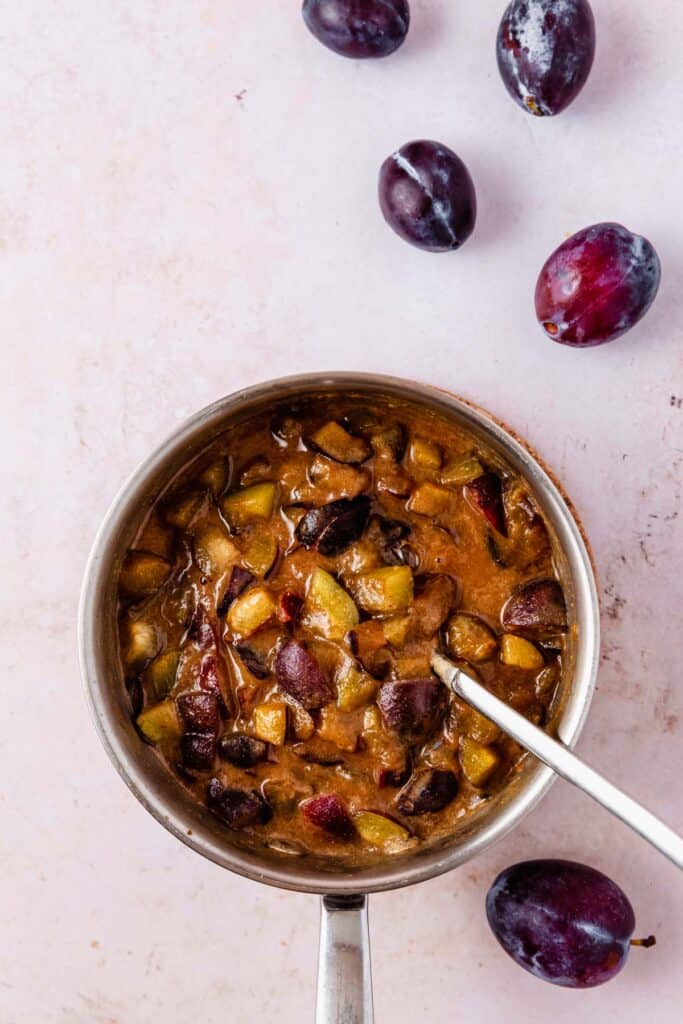 a pot of spiced-plum jam ingredients