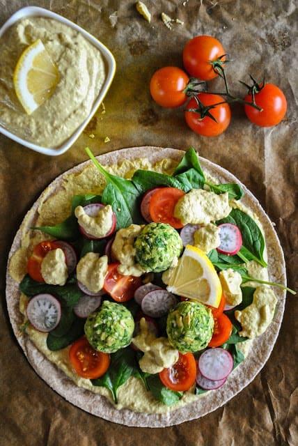Open vegan wrap with spinach veggie balls