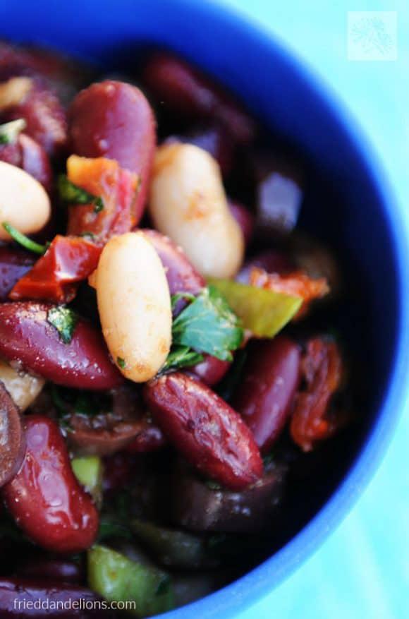 balsamic bean salad in a blue bowl