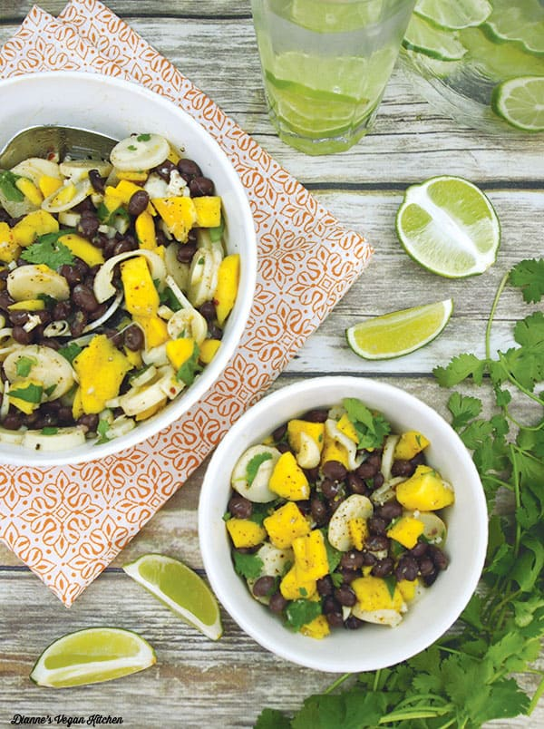 black beans and mango salad in bowls with lime