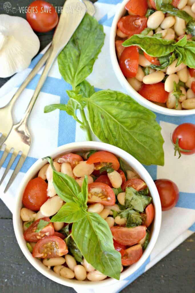 white bean cherry tomato salads topped with basil