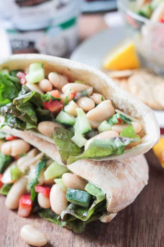 white beans, lettuce, peppers in a pita