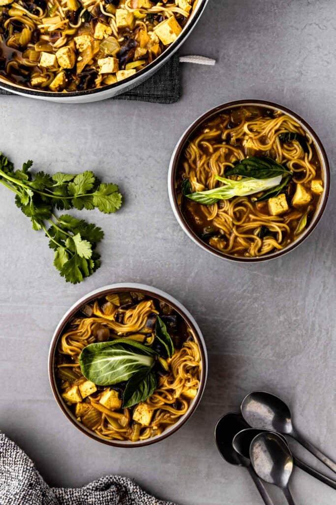 golden ramen bowls with cilantro garnish