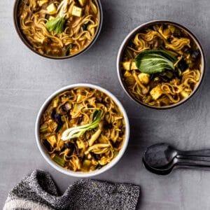 three bowls of curry ramen