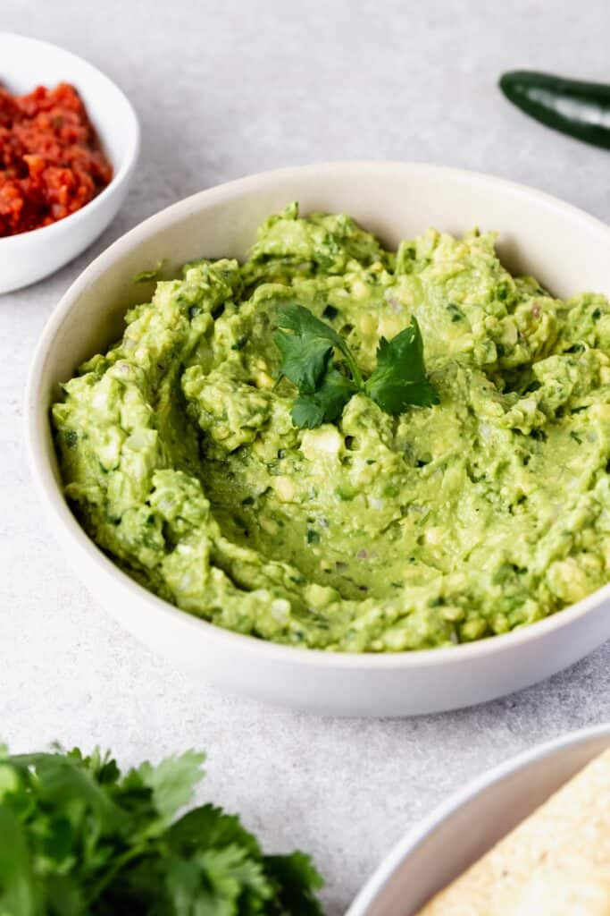 homemade guacamole topped with cilantro