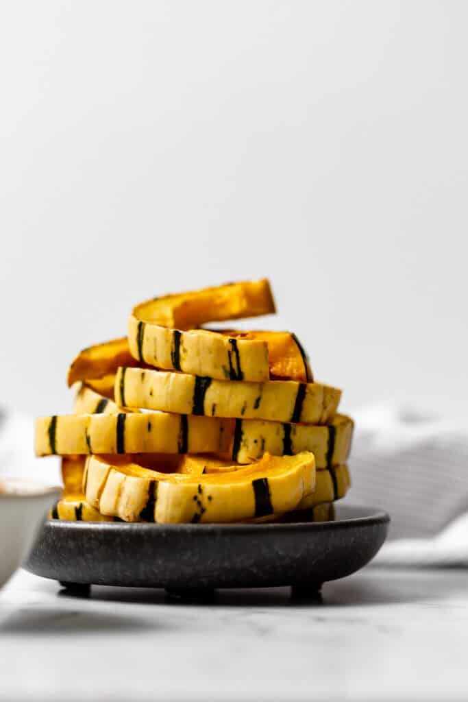 a stack of roasted delicata squash slices