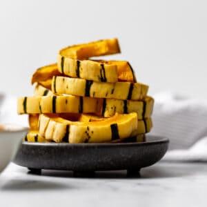 a stack of delicata squash