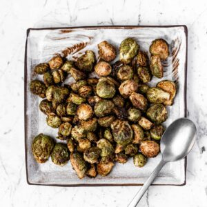 roasted brussels sprouts on a square plate