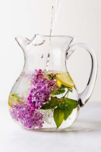 Lilac and lemon water in a large pitcher