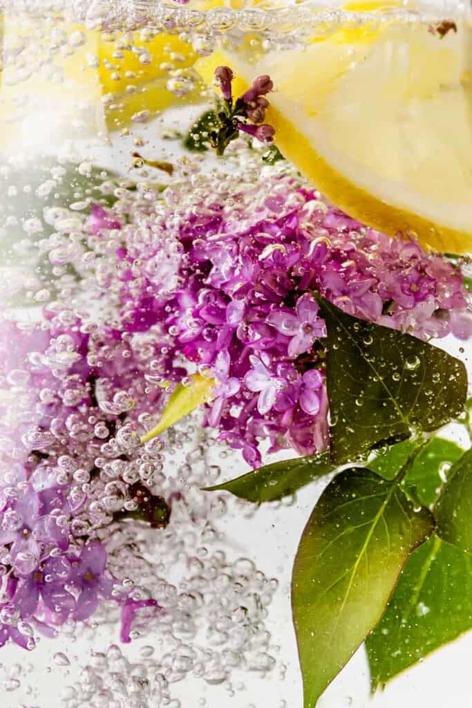 A close-up of lilac and lemon water