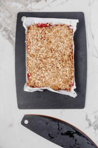 baked batch of strawberry rhubarb bars uncut