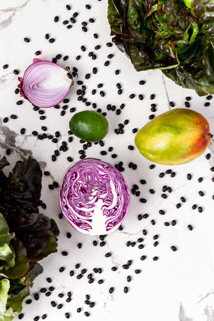 Ingredients to make vegan mango taco salad