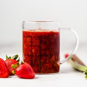a pitcher of strawberry rhubarb compote