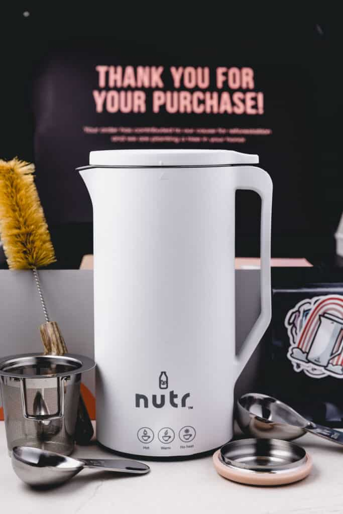 The Nutr Machine just unpacked from its eco-friendly packaging with included tools.