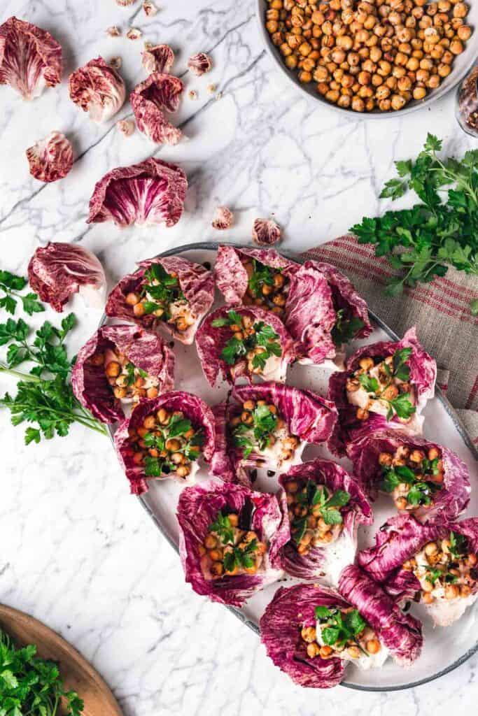 radicchio leaves stuffed with hummus and chickpeas