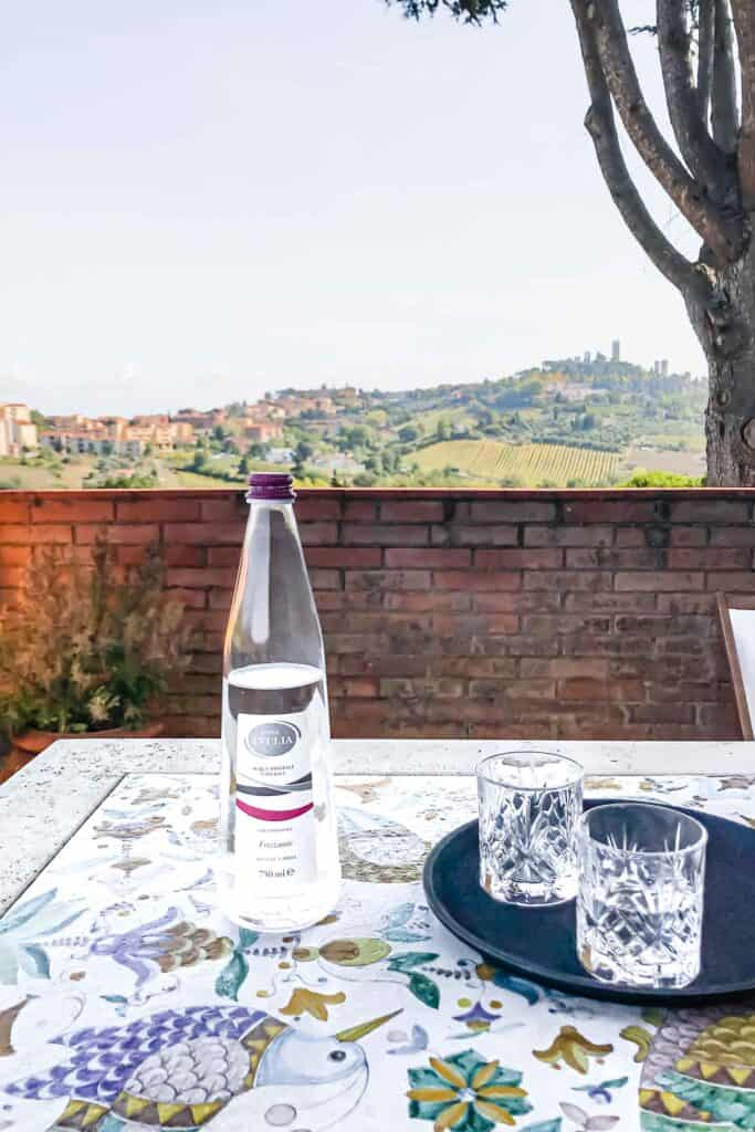 eating al fresco with a view of san gimignano